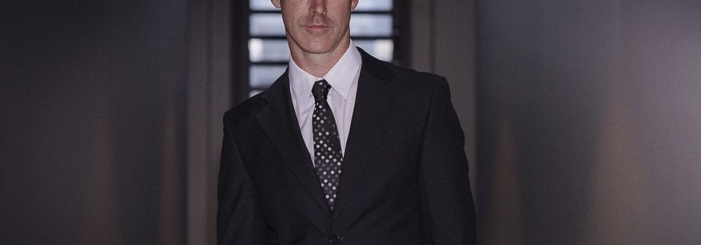 Photo of Melbourne male escort in a suit