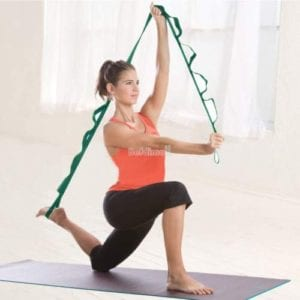 photo of woman stretching with strap with handles