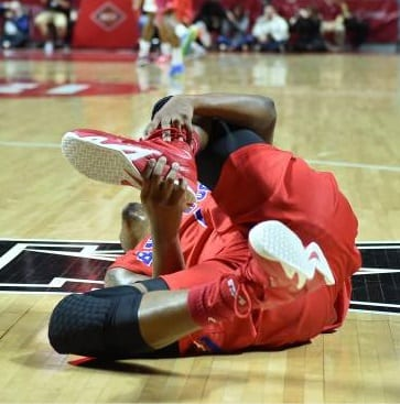basketball player falling with ankle injury